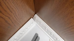 Mitered corners vs. coped corners cut crown with a compound miter saw